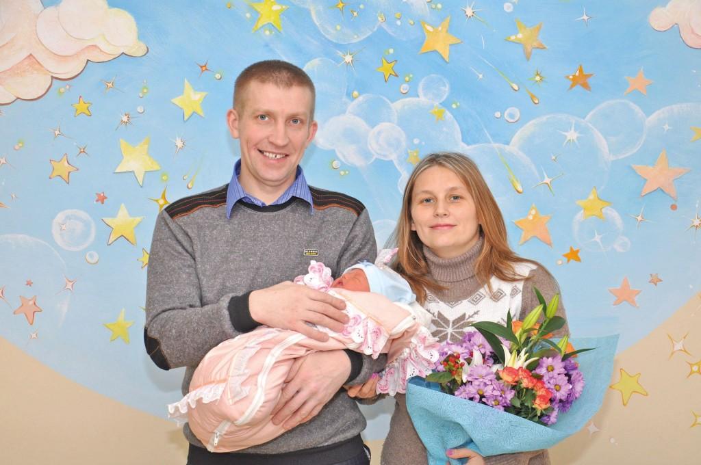 Андрей и Юлия Меркушовы с Виталиной